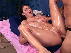 Witness this video where a brunette babe, with a nice ass and big tits, goes hardcore with a dirty dude covered in oil. She's a kinky woman!