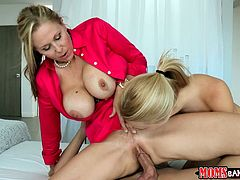 Have fun with this hardcore scene as you watch the busty Julia Ann and her naughty daughter sharing a guy's thick cock in a threesome.