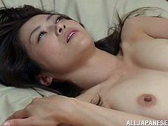 Witness this clip where an Asian cougar, with small boobs and a hairy pussy, while she gets nailed hard by an aroused fellow and moans loudly.