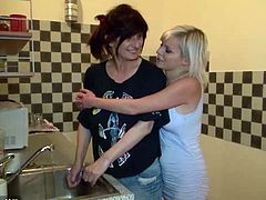 This sexy mature lesbian gets her yummy pussy licked in the kitchen by a gorgeous blonde teen and they both end up getting fucked by a hung dude.