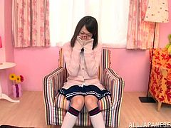 Get a boner by watching this Japanese doll, with a nice ass wearing a miniskirt, while she sucks a big cock and does it like a kinky teen.