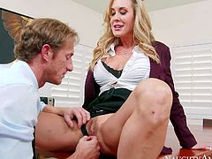Brandi Love is one on one with her employee Ryan Mclane. He does his best to please his female boss. She sucks milfs toes for a start. Then she opens her legs and he gives her snatch a lick.