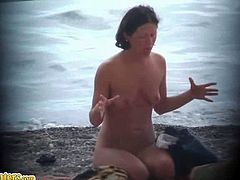 Sexy women of all ages can be seen on nudist beaches. They are minding their own business, taking baths in the sea and doing stuff on the beach completely naked.