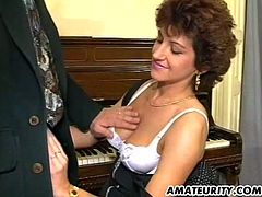 Sexy amateur with big natural tits sits on the piano stool while she gobbles a big cock and ends up getting a nasty cumshot after a hot threesome.