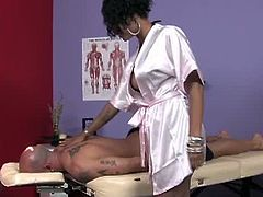 This ebony bombshell was this guy's first choice. She massaged his back a little and then she poured oil on her huge boobs before stroking his cock. He came on her tits.