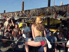 A group of nasty teens are having an outdoor party. The girls, wearing bikinis and miniskirts, show their butts and natura boobs and rub their cabooses against men's groins.