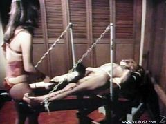 What are you waiting for? Watch this femdom brunette, with a nice ass wearing red lingerie, while she tortures another lady just for pleasure.