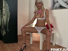 Pretty blonde with sexy ass and amazing tits dressed in a bunny costume gets taped by her partner. She takes her bra off and starts touching her sexy nipples. She gets horny so she takes her panties off too and gently rubs her shaved pussy.