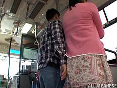 Take a look at this hot public scene where the slutty Asian babe shows off her big natural tits while sucking on a guy's hard cock on a bus.