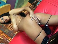 Curvy brunette Carmella Bing, wearing leather thong, is having a great time with two men. The dudes face-fuck the slut, then double team her and cum on her face.
