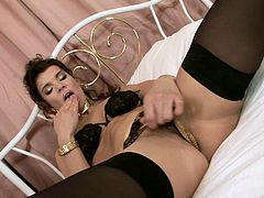 Insatiable skank wearing black nylon stockings sucks cock and gets rammed in a sideways pose. Then she gets her both holes polished by riding cock on top.