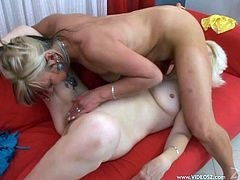 Two bodacious sapphic bitches start grabbing and kissing each other's natural boobs. Then they have oral sex in 69 pose and poke their twats with a dildo.