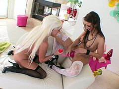 Kinky milfs Maria Bellucci and Nikita Von James, wearing lingerie and stockings, are playing lesbian games indoors. They finger their twats ardently, then drill them with oversized toys.