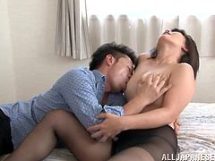 A kinky Japanese couple are having a nice time in a bedroom. They make out and pet each other, then fuck doggy style and moan with pleasure.