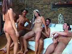These gorgeous babes have the time of their life as they get rammed hardcore in this nasty interracial orgy with two horny lucky dudes.
