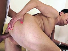 The horny mature woman Anastasia enjoys the taste of this stud's big hard cock and gets her yummy pussy drilled doggystyle.