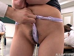 Get a load of this teacher's big natural breasts and her wet bush in this hot POV where she's fingered by a student while class is in session.