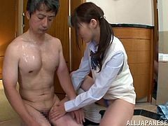 Watch the horny Rei Aimi giving this guy an oil massage before jerking and taking a ride on his hard cock after giving him a boner.