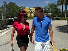 Big-breasted redhead milf Vanessa Bella, wearing stockings, kneels in front of a dude and sucks his schlong. After that they fuck in the reverse cowgirl and other positions.