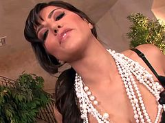 The stunning Sunny Leone wears some sexy black panties and gloves while she toys her hot dripping pussy with a big dildo.