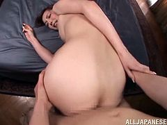 This hot Japanese babe rubs and licks this lucky guy's cock then she climbs on top of him and rides him until she cums hard.