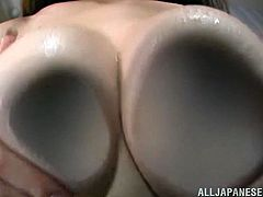 The gorgeous Azumi Kinoshit shows her perfect boobs and her big round ass before shoving a big black dildo up her sweet hairy pussy.