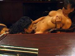 Big-breasted black chick is having a nice time with a guy in a bedroom. They fondle each other and fuck doggy style. Watch this backstage clip and learn more about the inside of porn movies.