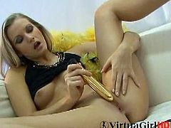 Sandy is a sensual blonde. She does kinky stuff, but she looks classy when she does it. Sucking on that golden vibrator looks like fun for her and toying her pussy too.