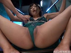 Slim Japanese tart gets tied up by two men indoors. The dudes play with the chick's tits, then rub her shaved pussy with dildos.