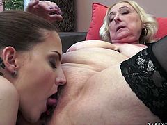 Pretty brunette examines stretched snatch of dirty mature harlot
