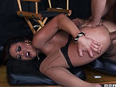 Sizzling brunette tart Mia Lelani, wearing a bra and stockings, is having fun with Jordan Ash and Voodoo. Mia favours the guys with blowjobs and allows them to sandwich her and cum on her face.