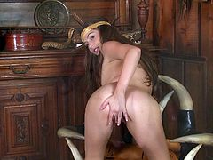 What are you waiting for? Watch this brunette doll, with natural breasts wearing an indigenous costume, while masturbates until she cums.