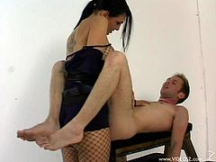 Take a look at this hot pegging scene where the sexy brunette Victoria Sin plays a horny officer fucking a guy with a large strapon on.