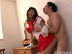 Mao Hamasaki is wearing her school uniform and she just loves clothed sex. The kinky Japanese chick slurps on his dick and lets him drill her hard.