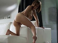 Appealing beauty with sexy nude forms amazes in raw solo by deep finger fucking her tight vag