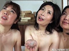 Three well-endowed Japanese moms show their big natural tits to a dude. Then they kneel in front of the man and suck his weiner by turns.