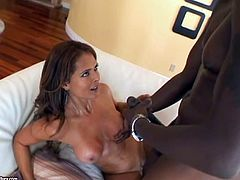 A gorgeous cougar with long dark hair, big beautiful tits and a great body enjoys a hardcore interracial fuck on her sofa.