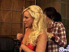 Admirable blonde enchantress wearing sexy red lingerie gives an interview showing her awesome curves. Then Isis Taylor joins her and they pose for camera.