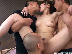 Well-endowed Japanese hottie lets two dudes play with her big natural jugs and hot pussy. After that she allows the studs to fuck her pussy from behind by turns.