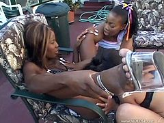 Check out this amazing lesbian scene where these smoking hot ebony babes have a threesome outdoors that you don't want to miss.