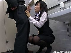 Ayu is a sexy flight attendant who goes into the bathroom with the pilot of the plane, gets on her knees and sucks his cock.
