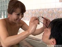 Get excited by watching this Asian MILF, with natural gazongas and a nice ass, while she serves a great titjob and gives pure pleasure.