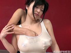 Take a nice look at this asian brunette, with big knockers wearing a bathing suit, while she gets her pussy out of control and moans stridently.