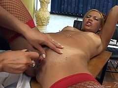 Pigtailed blondes Morgana Dark and Sabrina Lins are playing dirty games in a lecture room. The lesbians caress each other and use a dildo to fuck each other's twats.