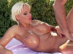 Watch the busty blonde Jordan Pryce getting an oil massage from this guy as you watch him finger her pink pussy outdoors.