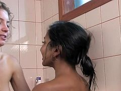 Black skinned lesbo lovely has fingered by the blonde inside A whirlpool tub tub