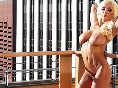 Lindsey shows that she isn't shy as she goes up on the roof of her building and strips off her clothes so her big tits can breathe.