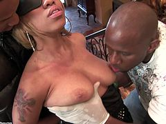 A sexy ebony-skinned girl with long blonde hair, big tits and an awesome body enjoys a mind-blowing gangbang in her bedroom.