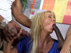 For this blonde cougar, nothing is better than a giant black dick, that's why today she is playing with two at the same time.See how these two monster black cocks fucks this blonde cougar till they cream her face and tits.