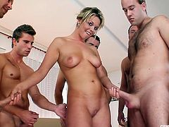 Skanky blondie wit big round tits takes on six cocks at once